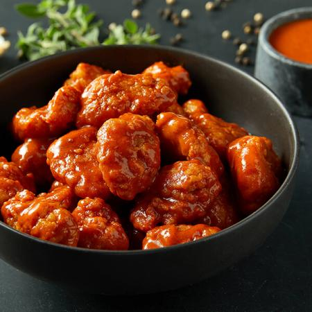 $4.99 12 Boneless Wings with Purchase of a Large Pizza At Regular Price